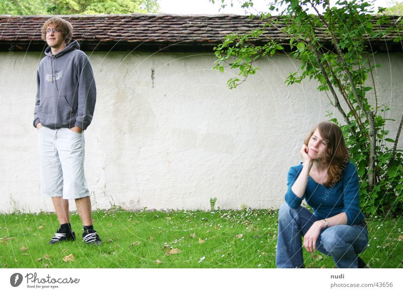 Woman Man Far-off places Grass Wall (barrier) Think Friendship Moody Future Stand Bushes