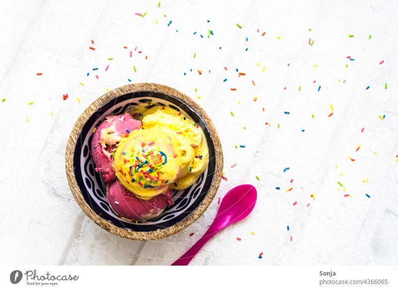 Vanilla and strawberry ice cream with sugar sprinkles in a bowl. Top view Vanilla ice cream Strawberry ice cream Dessert Ice cream Summer cute Food Delicious