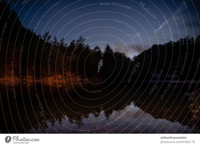 Night shot of calm water under starry sky in forest Nature Exterior shot Deserted Landscape Lake Water stars Starry sky Starlit Night sky Long exposure