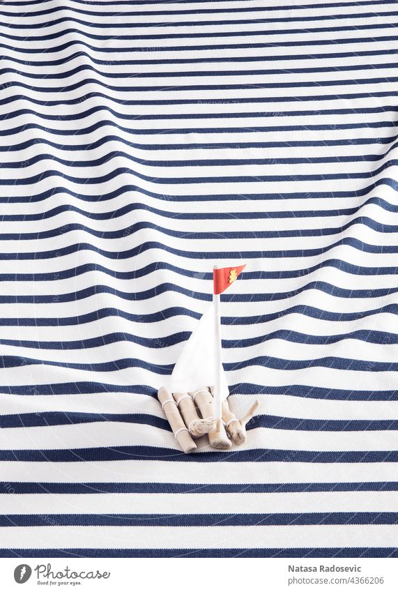 Wooden raft with a white sails on a sailor's shirt instead of the sea. background summer concept Abstract marine Contemporary Rectangle aesthetic art blue boat