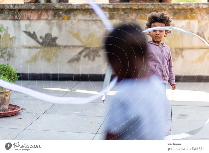 children playing in the patio happy summer black african american day house family kid young girl outside boy home lifestyle fun together outdoors terrace