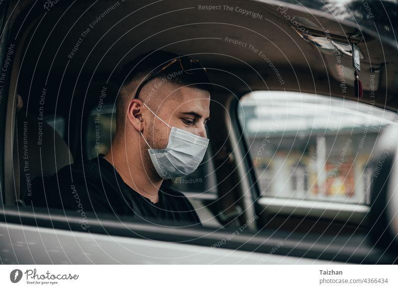 Portrait of driver wearing protective medical mask coronavirus driving epidemic illness passenger protection quarantine traffic transportation person taxi man