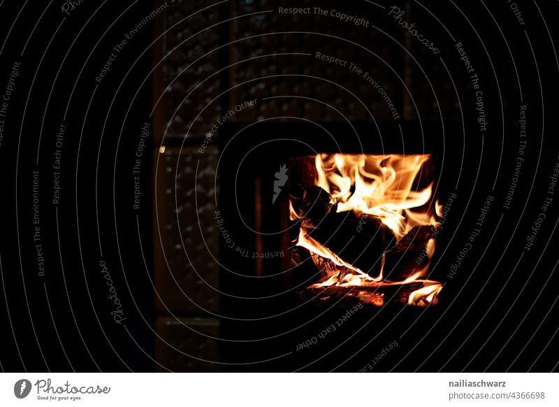 fiery Fire Fireplace Fireside kiln Winter Cold Autumn autumn light autumn atmosphere Flame Dark traditionally Cozy Heat Heating heating engineering blaze Red