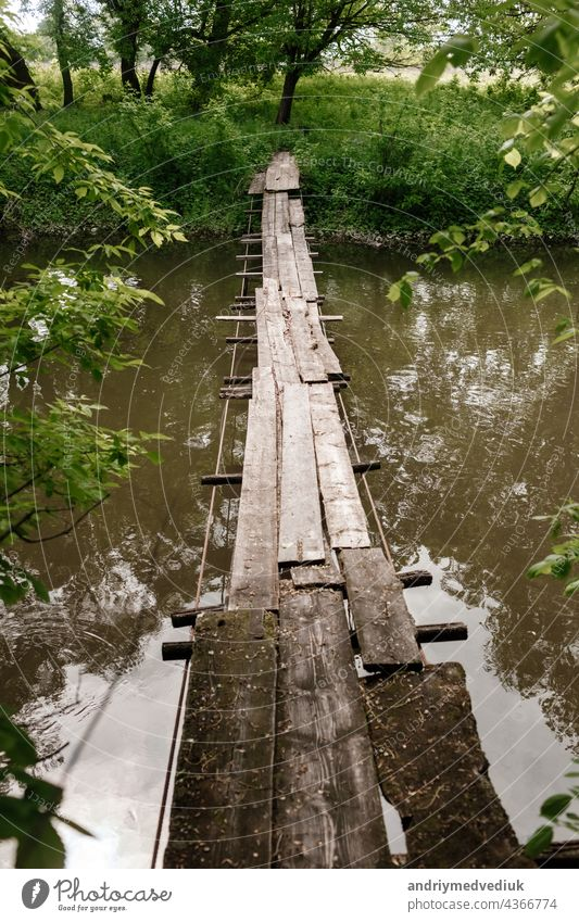 Old wooden bridge, wooden bridge across a small river, bridge with nature. forest landscape path water architecture background beautiful environment natural old