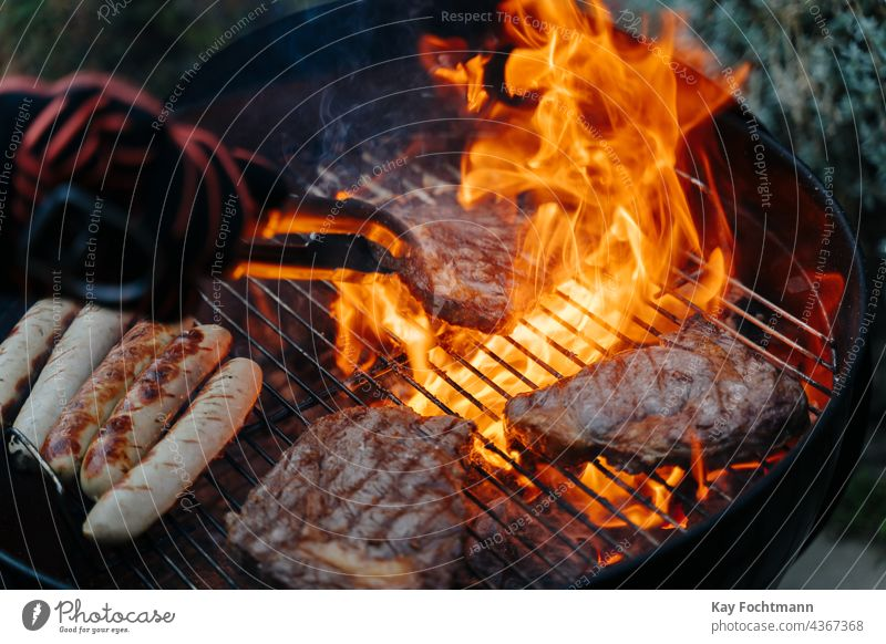 man turning steak on barbeque grill barbecue barbecue - meal barbecue grill bbq beef coal cuisine culinary delicious flames food and drink glowing gourmet