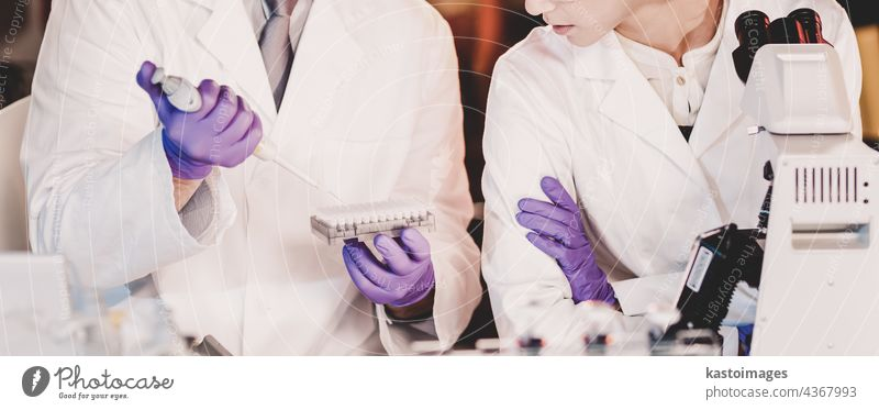 Life scientist researching in the laboratory. analyzing assistant bio biology cell chemist chemistry clinic coat development discover dna doctor education