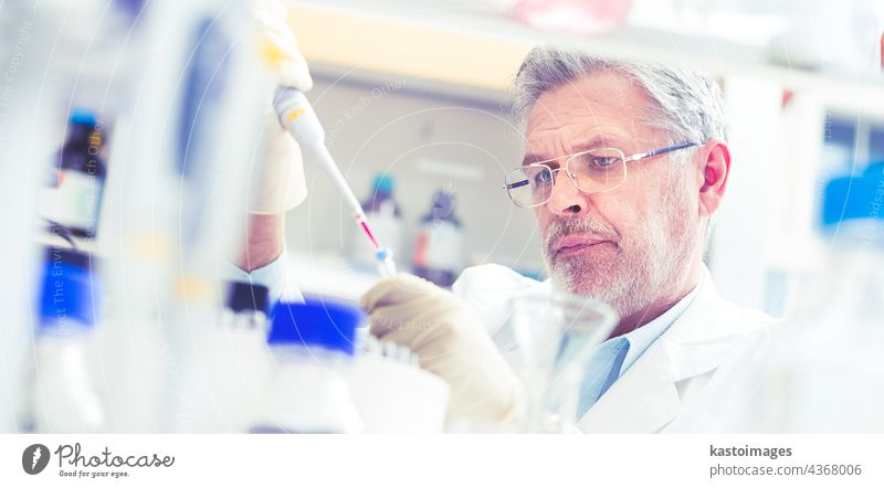 Life scientist researching in the laboratory. analysis analyzing biology biotechnology chemical chemist chemistry clinic coat develop discover doctor equipment