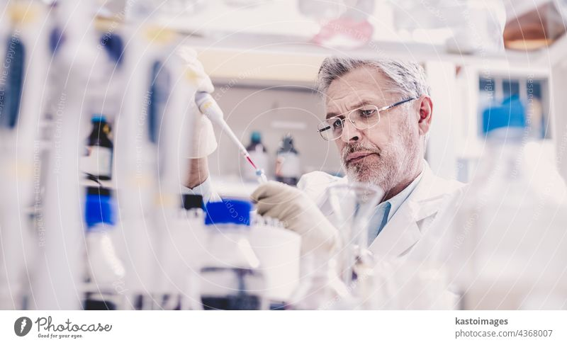 Life scientist researching in the laboratory. analysis analyzing biology chemical chemist chemistry clinic coat develop discover doctor equipment experiment