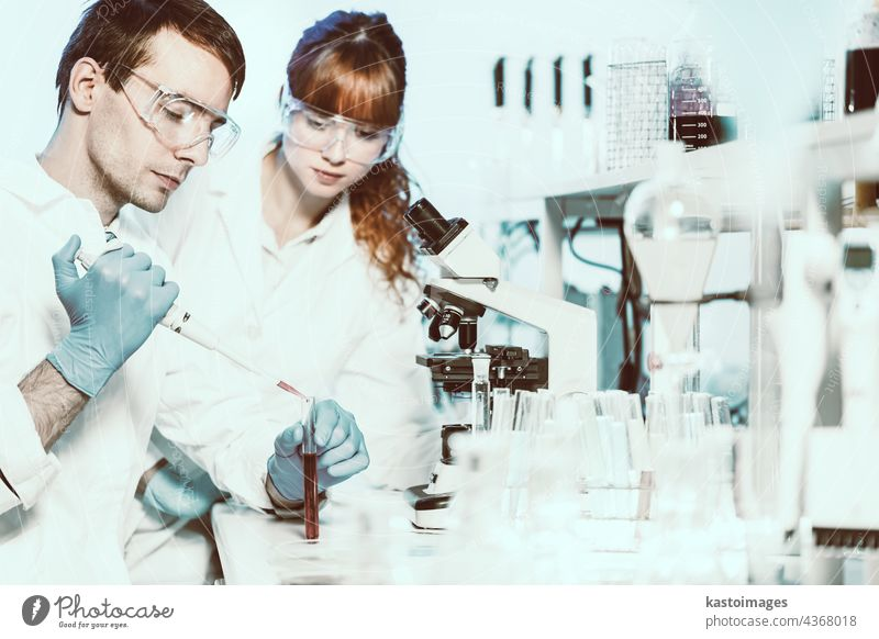 Health care students working in scientific laboratory. science research analysis scientist study supervisor team technician technology test tube workspace