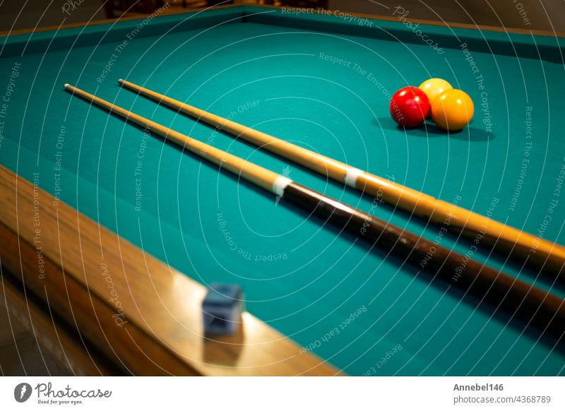 A green cloth billiards or pool table red,yellow and white ball,hobby and sport with copy space game leisure cue play snooker entertainment competition fun