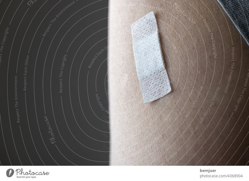 Patch on the arm after vaccination Bandage pavement vaccine medicine Illness Immunization immunisation covid-19 coronavirus prevention Healthy pandemic