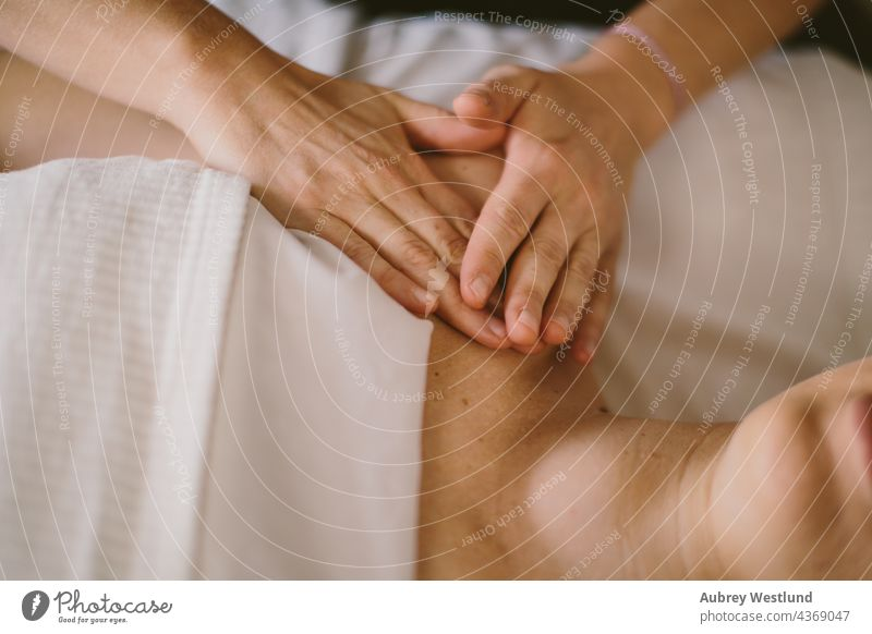 hands of masseuse giving a massage 25-30 30-35 35-39 adult back balance calm exercise female healing health healthy lifestyle indoor life coach