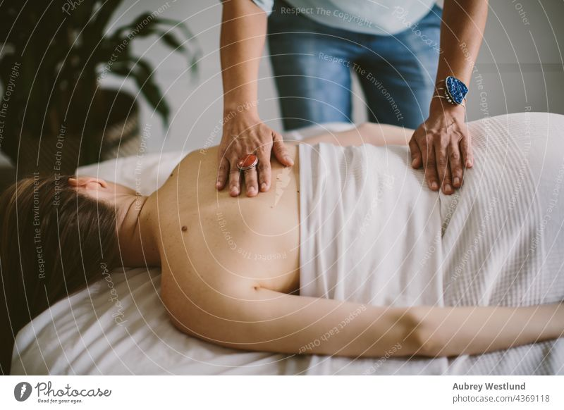 woman getting a back massage 25-30 30-35 35-39 adult balance calm exercise female hands healing health healthy lifestyle indoor life coach massage therapist