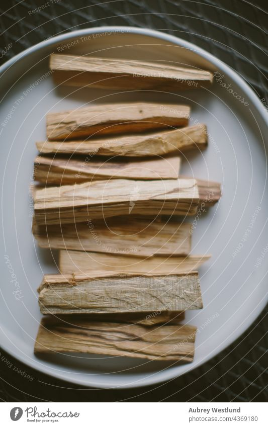 palo santo sticks for energetic cleansing balance calm exercise health healthy lifestyle indoor meditation peace people physiotherapy practicing practitioner