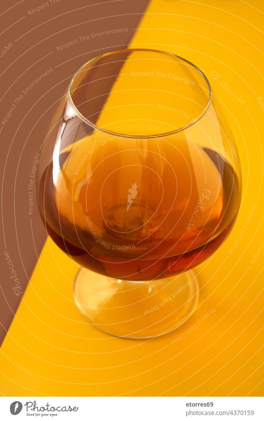 Cognac or whiskey drink alcohol alcoholic bar beverage bourbon brandy brown classic cognac coñac glass liquid old yellow