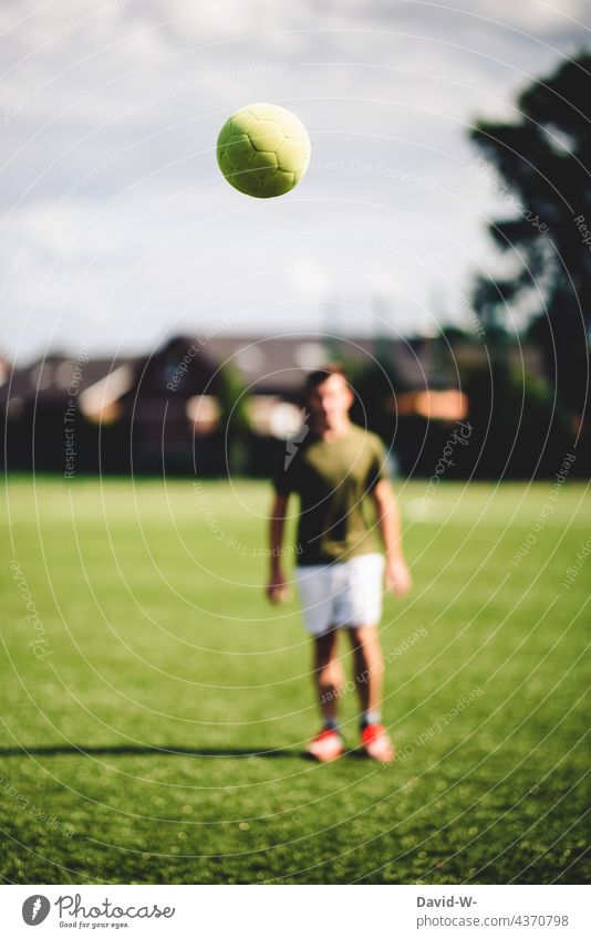 flying football and footballer Foot ball Soccer player Leisure and hobbies Movement Flying Sports Sportsperson Athletic out Football pitch workout Success
