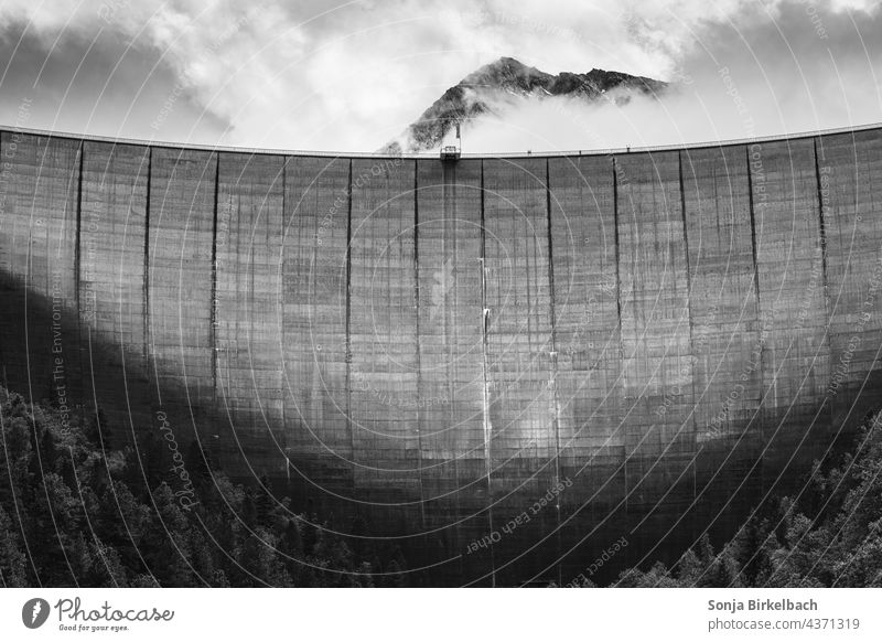 The Wall Wall (barrier) Retaining wall dam Reservoir Storehouse schlegeis Zillertal Alps Austria Europe Tyrol Tall mountains Clouds Dramatic black-and-white