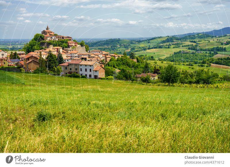 Landscape on the Tortona hills at springtime. View of Sarezzano Alessandria Colli Tortonesi Europe Italy Piedmont color day field green house landscape nature