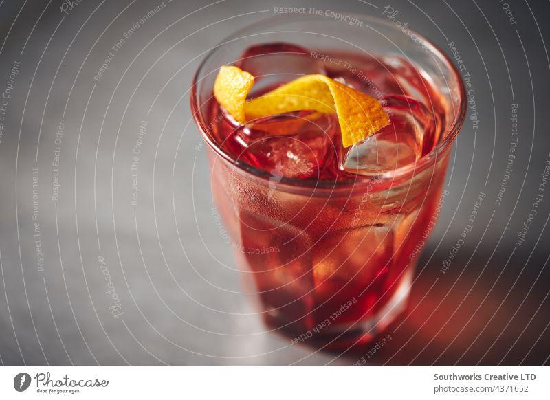 Old fashioned whiskey close up cocktail glass alcohol drink ice garnish zest nobody indoors day hospitality sophistication stylish style spirit full indulgence