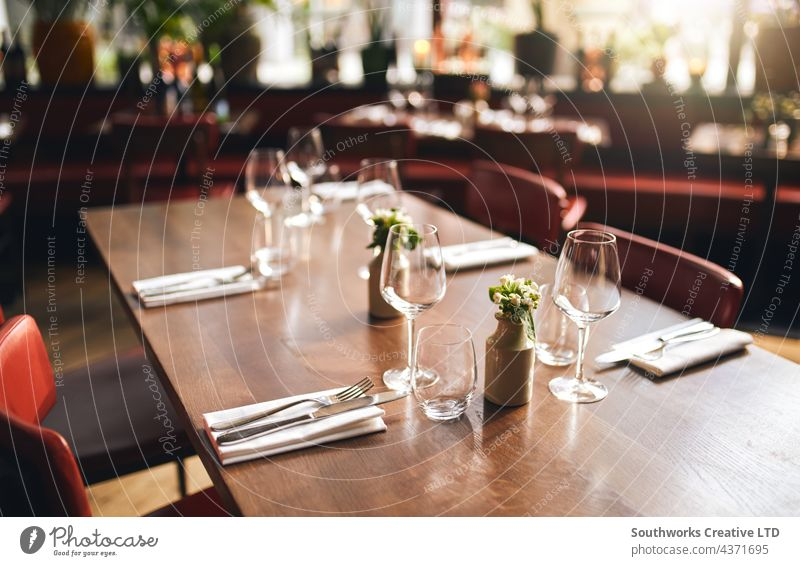 Glasses and cutlery on table in restaurant glass dinner empty hospitality food drink nobody indoors day venue dine eat preparation order organisation furniture