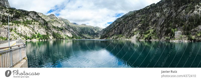 panoramic view of the Cavallers reservoir surrounded by high mountains, river Noguera de Tor in Ribagorza, Boí valley, Pyrenees lake Taull pyrenees Lleida