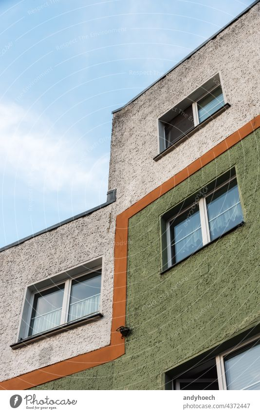 An orange line divides the facade of the house accommodation apartment apartments architectural architecture building city construction design development