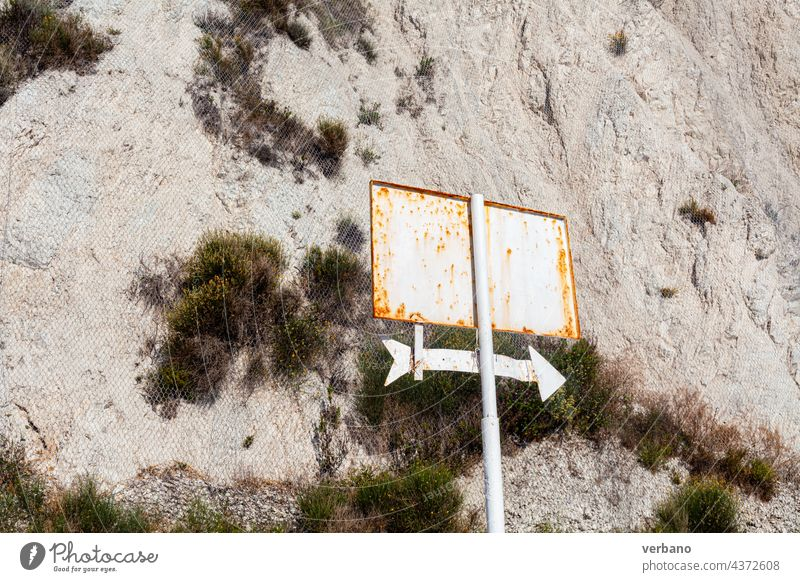 rusted sign outdoors with and arrow pointing right park empty no text rusty dirt white direction symbol pointer cursor next design down up orientation interface
