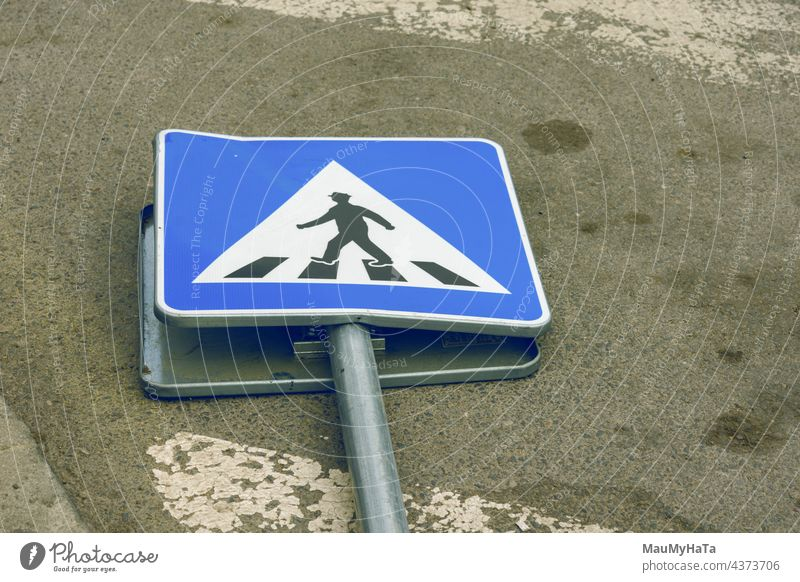 road sign demolished on the road Road sign Road traffic Signs and labeling Street Colour photo Exterior shot Traffic infrastructure Transport Town Day Safety