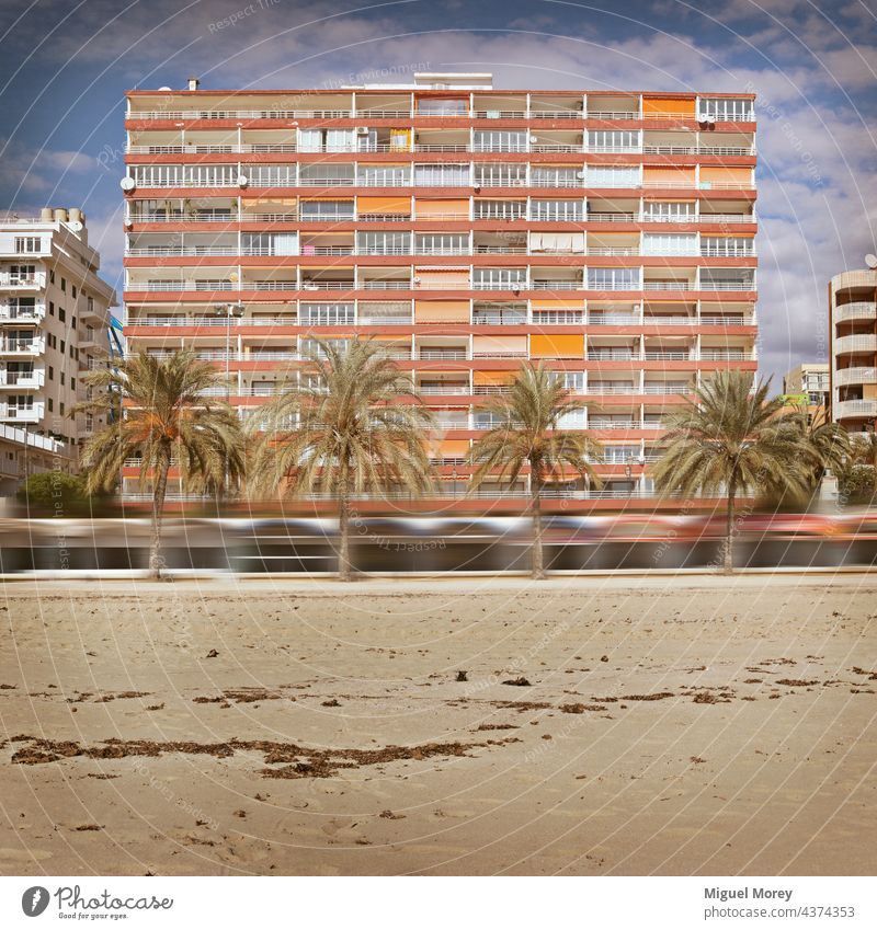 Apartment building on a sandy and palm-lined beach Apartamet Building Facade House (Residential Structure) urban Apartment house apartment building Window