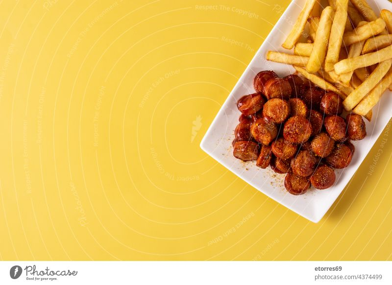 Traditional German currywurst food french fries fried german grilled homemade ketchup meal meat oktoberfest plate pork potato sauce sausage table tomato