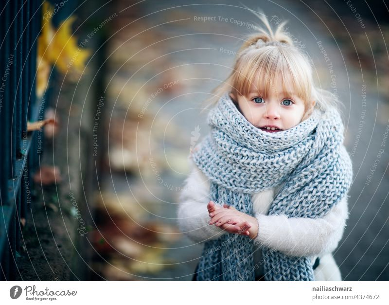 autumn. Autumn Autumnal Cold Scarf Child Infancy dreamily Park portrait Gorgeous Girl`s face Cute Outdoor photography kind Friendliness people outdoor smilingly