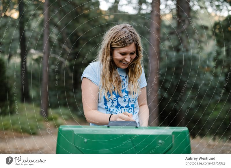 woman cooking at a camp stove in the forest baby blonde california camper camping campsite caucasian chair child childhood daughter family fire fun girl happy