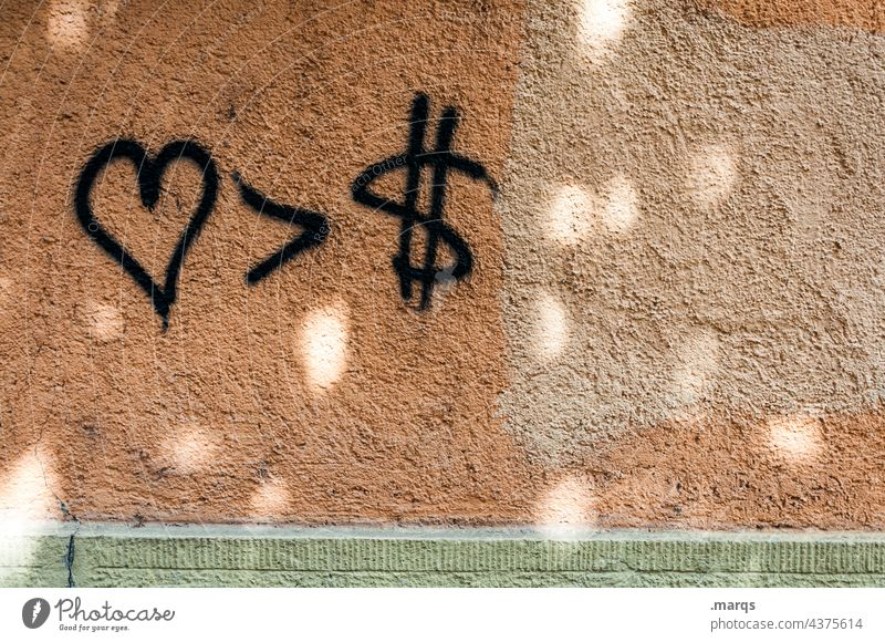 <3 > $ Love Humanity profit Money Avaricious Greed confident Hope Luxury Politics and state Symbols and metaphors Priority Wall (building)