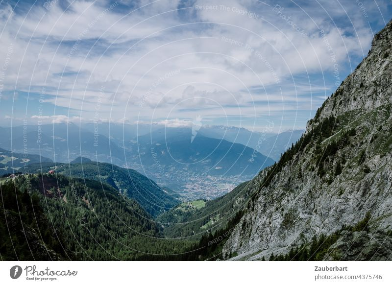 View from the ascent of the Ifinger over rugged rocks into the valley in the South Tyrolean Alps Looking Valley curt Rock Sky Clouds farsightedness Peak