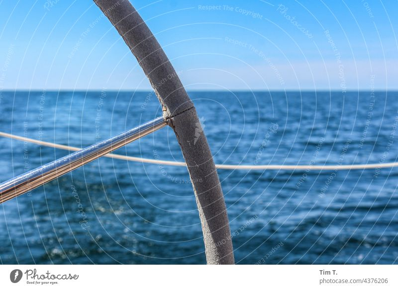 a piece of the rudder of a sailing ship Sailing Oar control Colour photo Exterior shot Watercraft Ocean Navigation Sailboat Vacation & Travel Summer