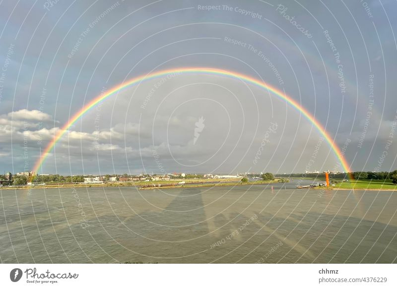 Rainbow over the Ruhr River River bank Rhine Exterior shot Landscape Reflection The Ruhr estuary Mouth of a river Storm Nature Sky Copy Space top shadow cast