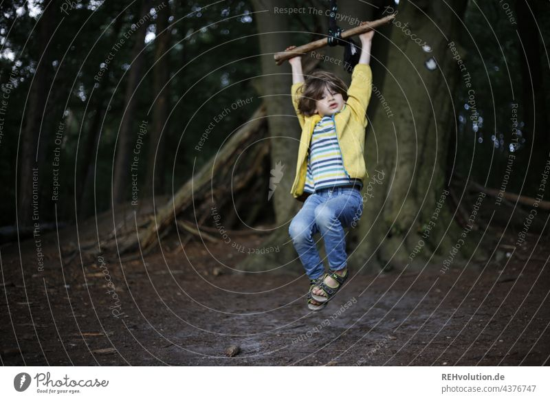 Child swinging in the forest 3 - 8 years Childhood memory Emotions Happiness To swing Children's game Movement Infancy Boy (child) naturally fun Happy Joy Swing