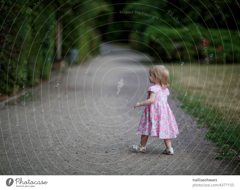 Mary dreamily Walking Lanes & trails Dusk Park Green Evening Gorgeous Child Girl`s face Infancy Cute Outdoor photography outdoor people Friendliness smilingly