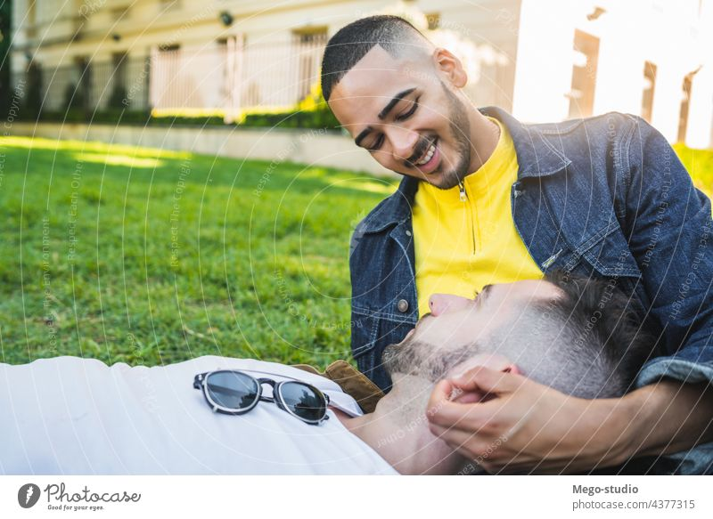 Gay couple spending time together at the park. gay love relationship resting date lovely partnership positive relax freedom life young pride nature dating
