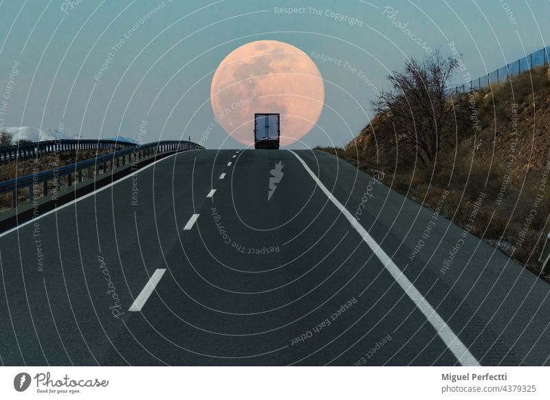 Refrigerated truck on a highway, at the top of a slope with the full moon in the background. road refrigerated truck horizon travel transport delivery nature