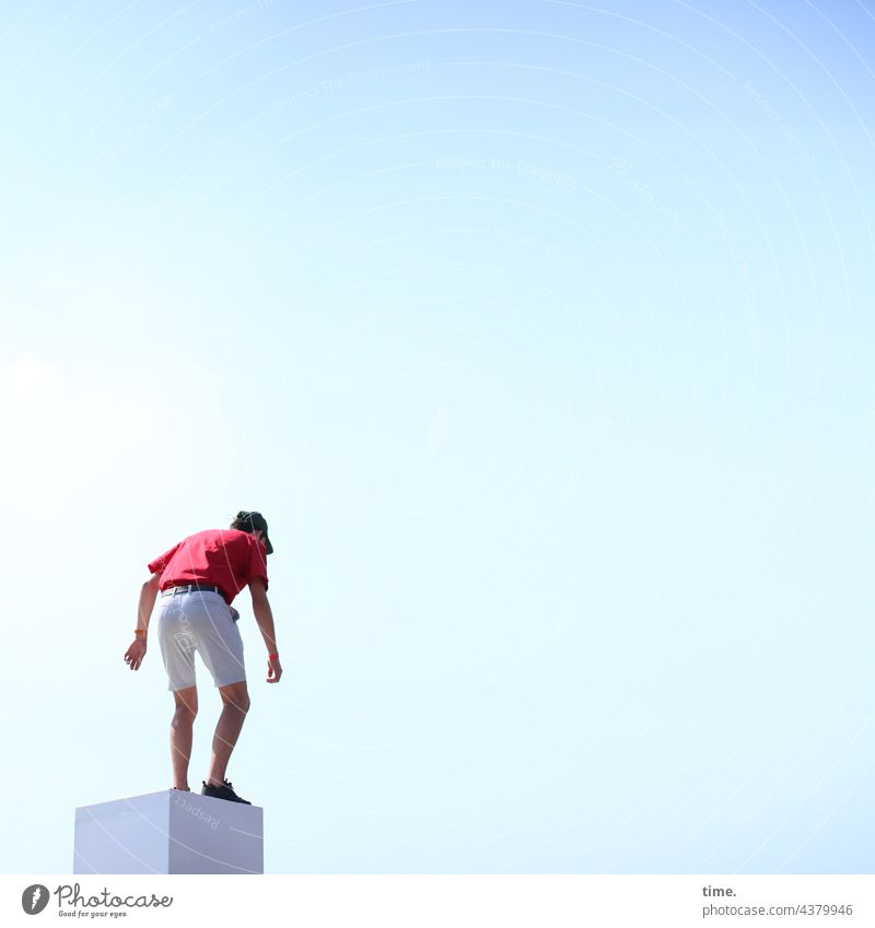 Risk assessment Man Stand Block cubes Manmade structures look Sky Free space Summer cap ready to jump sunny contrasted Concentrate observantly focused