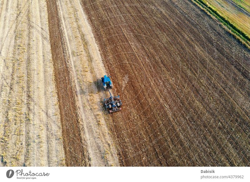 Tractor plows ground on cultivated farm field tractor farming agriculture nature technology spring machine equipment machinery agricultural land industry