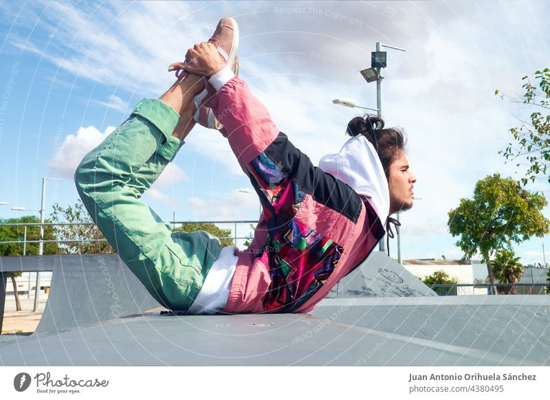 Young skater dancing hip-hop freestyle in a skate park teenager people man young skateboard pirouette twirl skateboarder casual dancer skatepark sport lifestyle