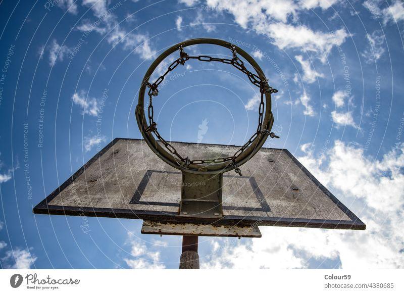 Basketball hoop leisure basket game sky outside sport basketball play competition high net goal recreation background score win team court blue street backboard