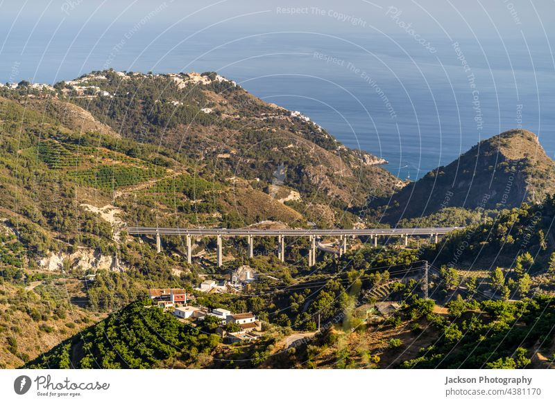 Beautiful landscape of Andalusian coast in La Herradura, Spain spain andalusia mountain hills highway orchard summer green residential architecture mountains