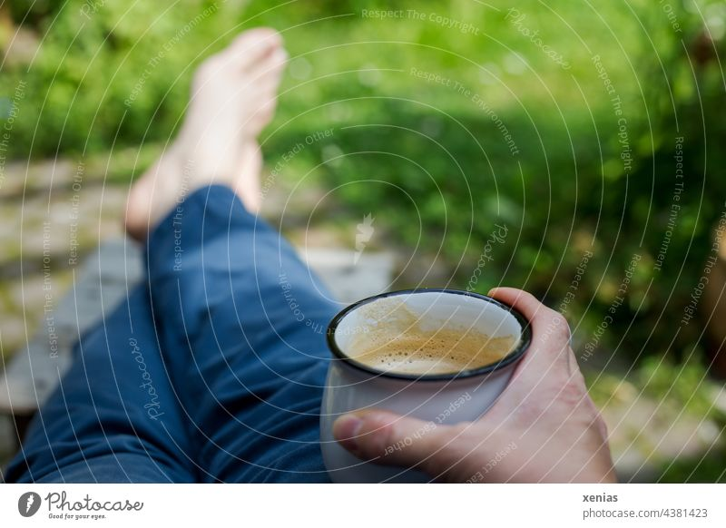 Spaces / taking a break with coffee in hand and feet on the stool between all the green Break Coffee Coffee mug To have a coffee Cup Hand Garden Green Pants