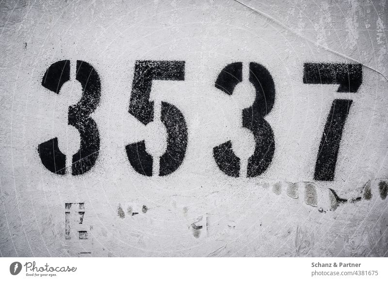 four-digit number on a wall figures Wall (building) payment code numerically numbering 3 5 7 Code Digits and numbers Signs and labeling Characters House number