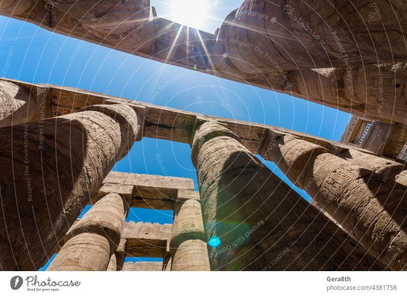 antique columns in a karnak temple in luxor Luxor ancient architecture blue building cairo civilization culture day egypt egyptian culture excursion famous
