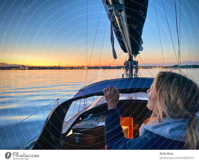 Woman on a yacht looking towards the evening sky on the Kiel Fjord Sailboat Sailing Baltic Sea Ocean Water Exterior shot Vacation & Travel Freedom Yacht