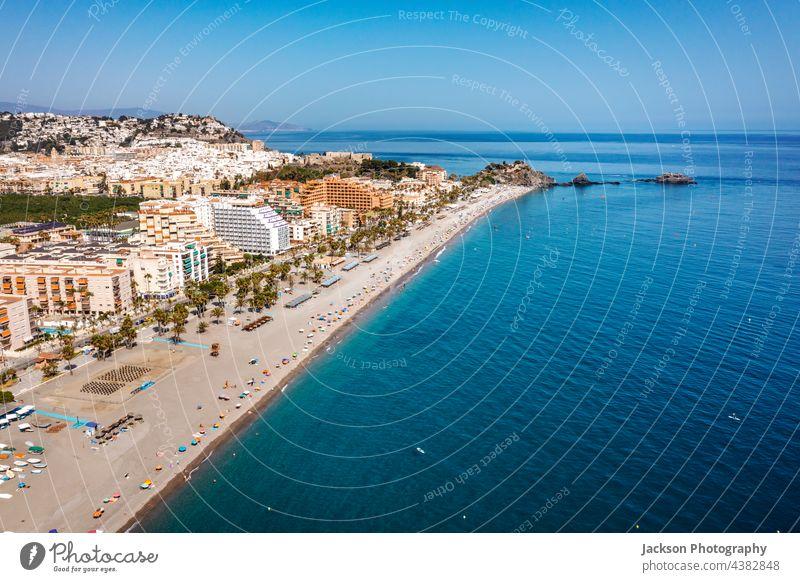 Aerial view of touristic coast in Almunecar, Andalusia, Spain spain almunecar beach urban andalusia mountain coastal day andalucia ocean seascape architecture